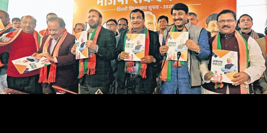 Union ministers Nitin Gadkari, Prakash Javadekar and Harsh Vardhan along with Delhi BJP chief Manoj Tiwari at the launch of poll manifesto