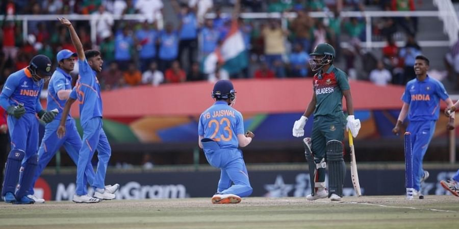 India's Yashasvi Jaiswal (C) celebrates after India's Ravi Bishnoi dismissed Bangladesh's Towid Hridoy (2nd L) during the ICC Under-19 World Cup cricket finals. (Photo | AFP)