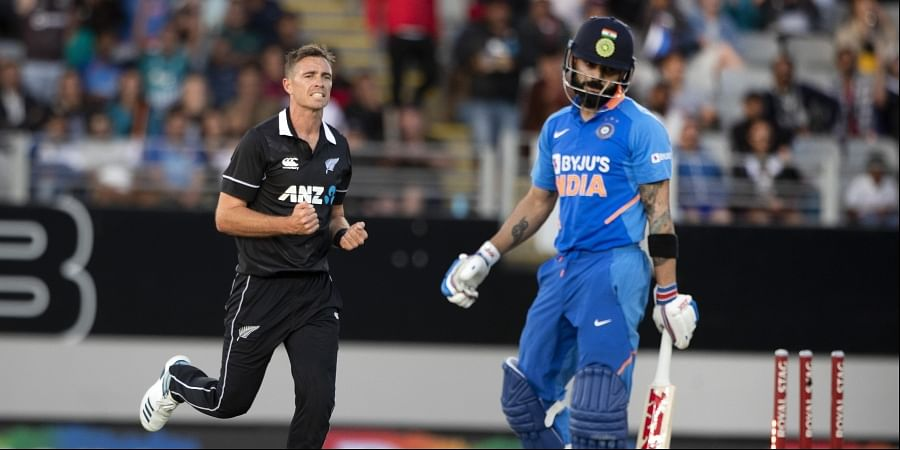 Black Caps bowler Tim Southee, left, celebrates the wicket of India's Virat Kohli. (Photo | AP)