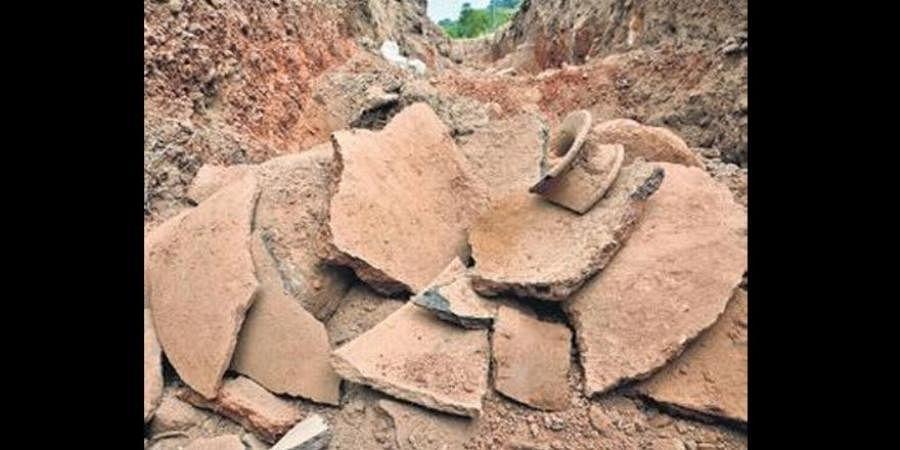 Damaged earthenware in Adichanallur archaeological site.