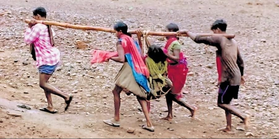 Maina Bisoi went into labour following which her family members carried her to Dasmanthpur PHC on their shoulders by crossing Pada river.