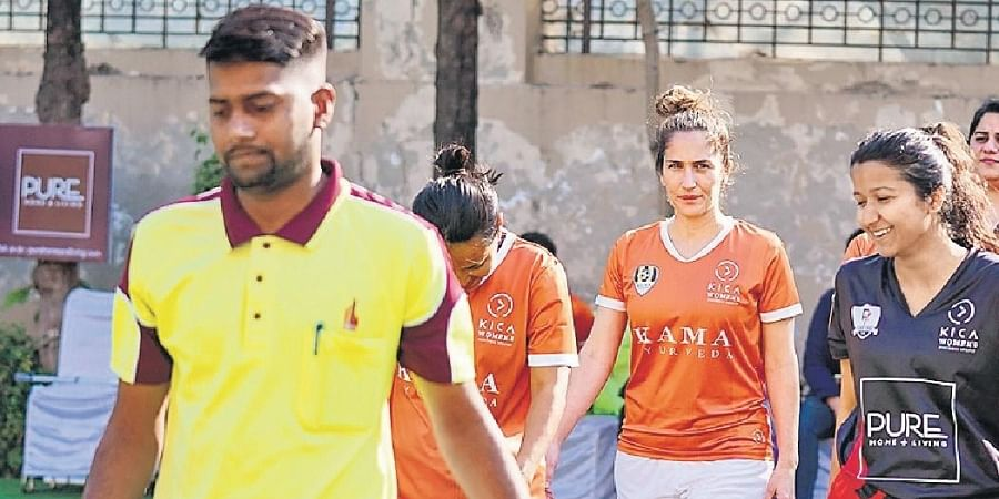 Competing teams line up for a match in the Kica Womens' Football League in Delhi