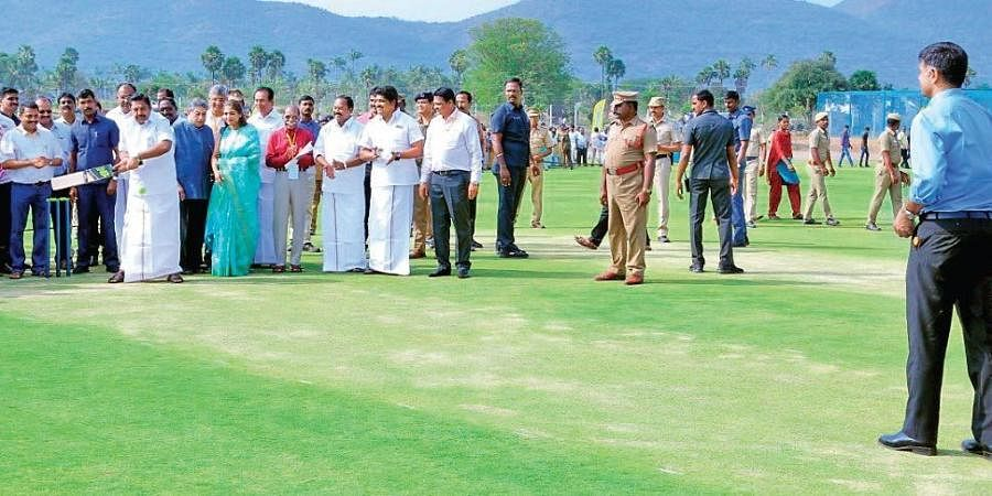 Tamil Nadu CM Edappadi K Palaniswami bats as former India captain Rahul Dravid gives a throwdown at the Salem Cricket Foundation ground, which was inaugurated on Sunday.