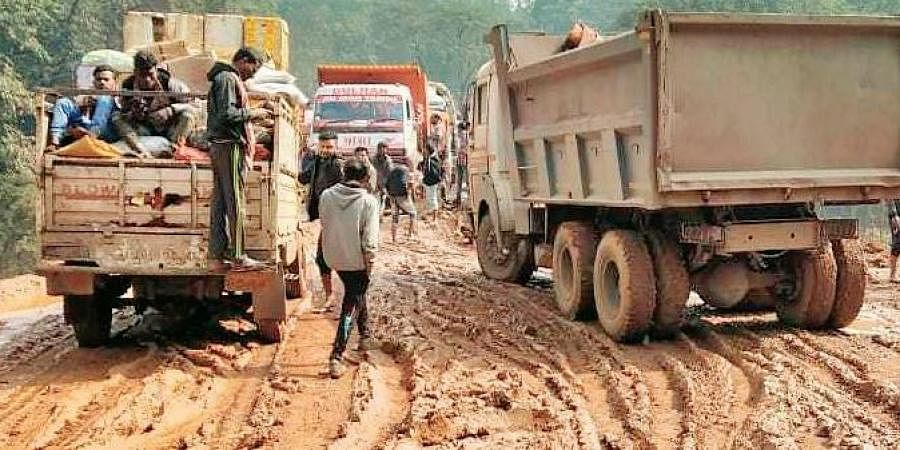 Vehicles stuck in the muddy road