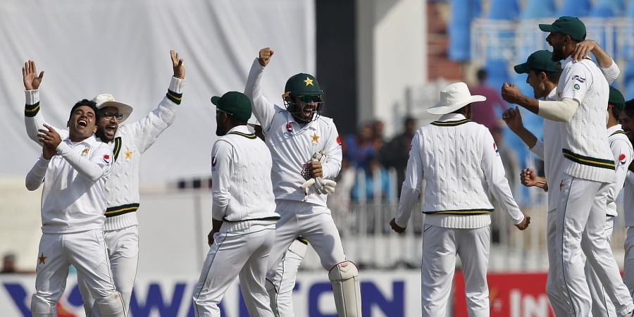 Pakistan's cricketers celebrate after the dismissal of Bangladesh's Rubel Hossain during the fourth day of the first cricket Test match between Pakistan and Bangladesh at the Rawalpindi Cricket Stadium in Rawalpindi on February 10, 2020.