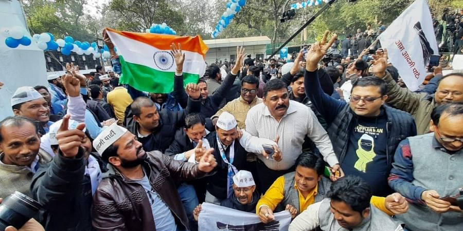 AAP workers celebrate after party's victory in Delhi elections 2020.