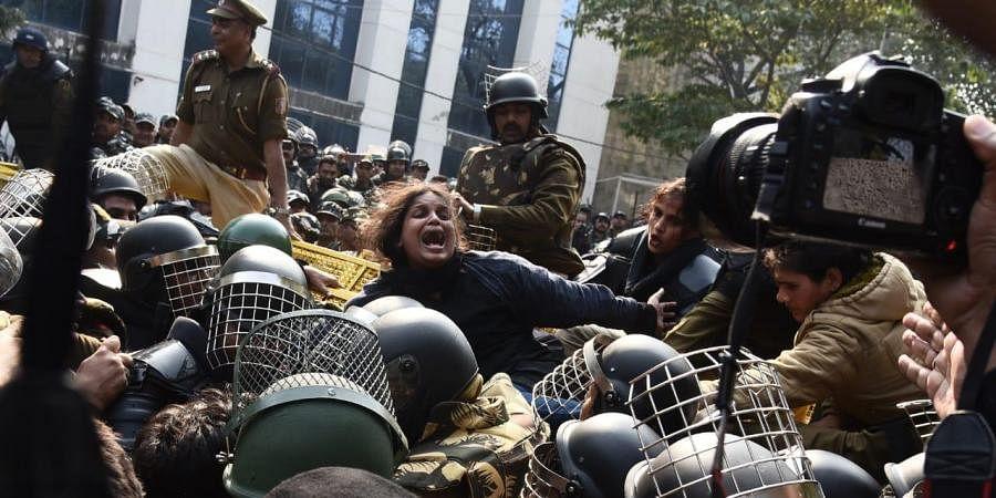Demonstrators protest against the CAA and NRC near Jamia Millia Islamia University in New Delhi on Monday.