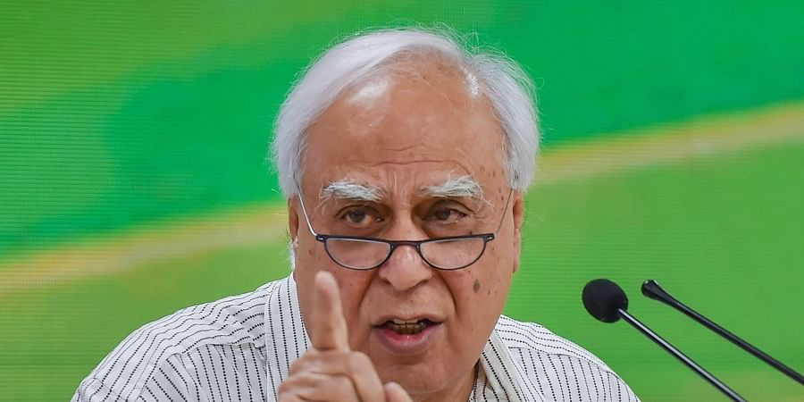 Senior Congress leader Kapil Sibal addresses a press conference at party headquarters in New Delhi.