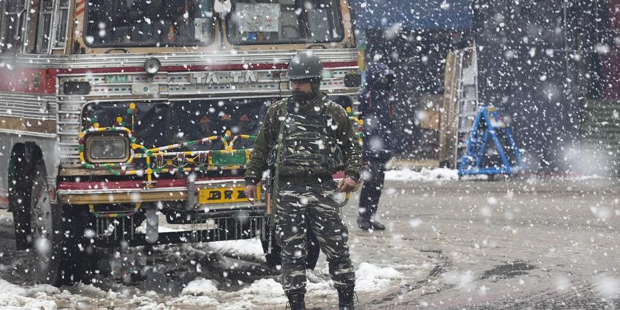 An Indian paramilitary soldier stands guard as snow falls in Srinagar, Indian controlled Kashmir, Wednesday, Jan. 15, 2020. (Photo | AP)