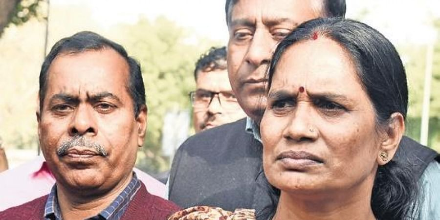 Asha Devi (R) Nirbhaya's Mother and Nirbhaya's father (L) outside the Delhi High Court after hearing of 2012 gang rape case in New Delhi on Wednesday.