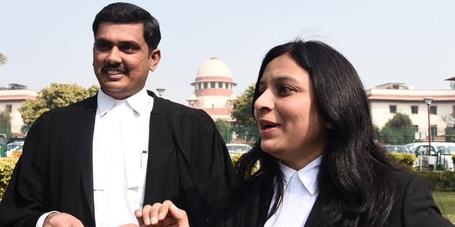 Petitioners advocate Prithviraj Chauhan and Priya sharma addresses media over SC verdict  on  SC/ST (Amendment Act at the SC lawn on Monday.