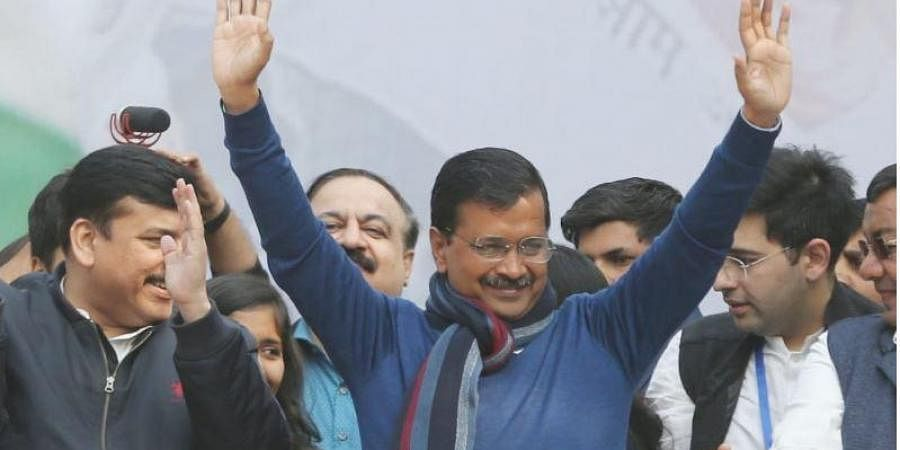 Delhi CM Arvind Kejriwal greets supporters after the landmark victory in Delhi elections at party headquarters in New Delhi on Tuesday