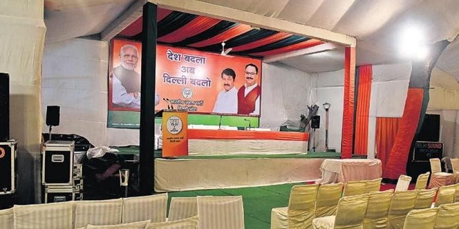 Empty chairs in front of a stage set up inside the Delhi BJP office.