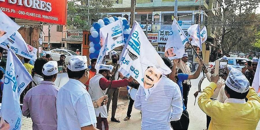 AAP workers celebrate the party's Delhi assembly poll victory, in Bengaluru on Tuesday.