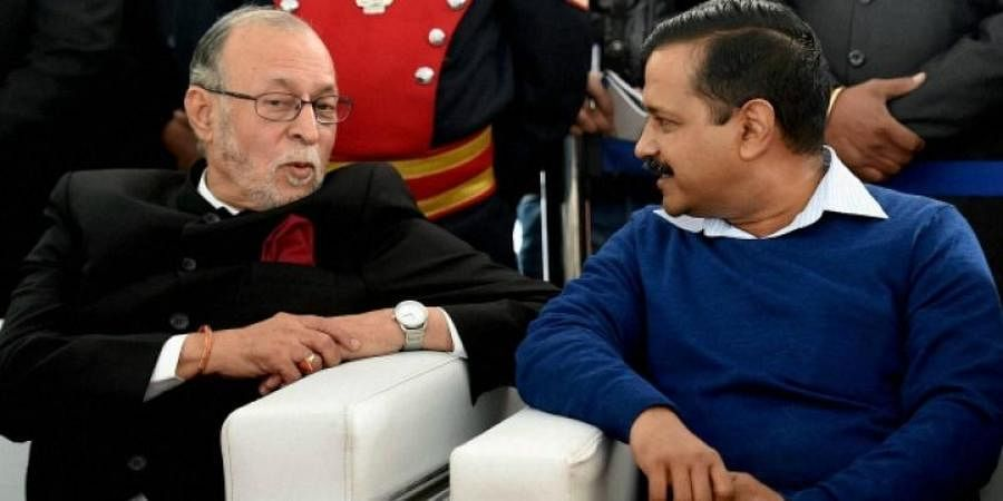 AAP chief Arvind Kejriwal (R) with Delhi Lieutenant Governor Anil Baijal