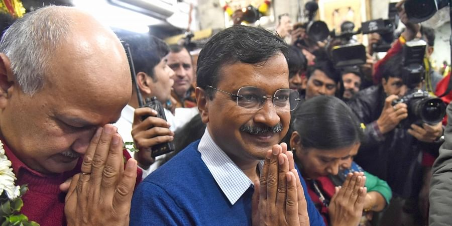 Delhi CM and AAP convenor Arvind Kejriwal, accompanied by wife Sunita, Dy CM Manish Sisodia and other party leaders visits the Hanuman Mandir at Connaught Place