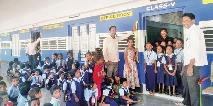 Students and teachers next to their school that is modelled like a train in Chinthalapally village of Kollapur mandal in Nagarkurnool