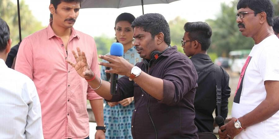 Director Rathina Shiva with Jiiva on the sets of Seeru