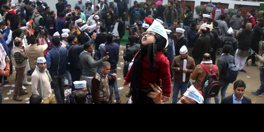 A young supporter of Arvind Kejriwal dressed like him at the AAP headquarters in New Delhi on Tuesday