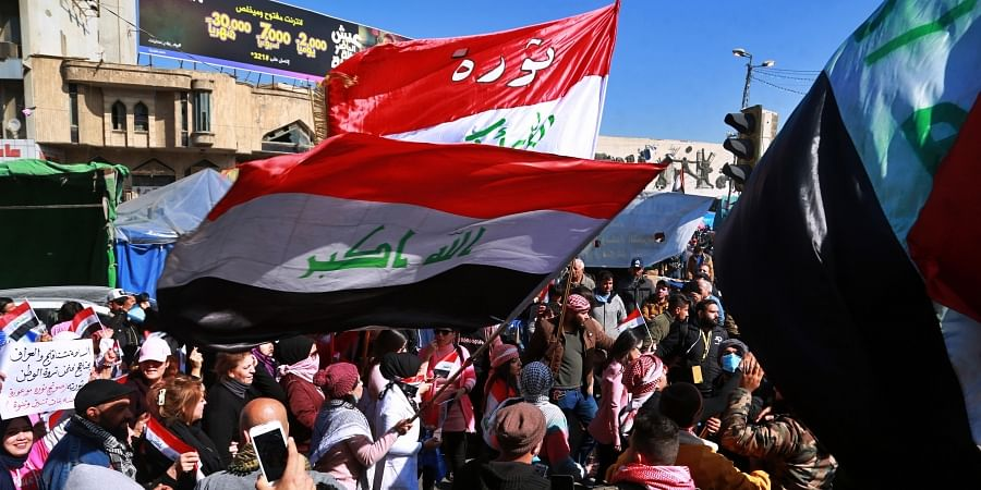 Hundreds of women took to the streets of central Baghdad and southern Iraq on Thursday in defiance of a radical cleric's calls for gender segregation in anti-government protest sites.