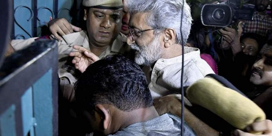 Human rights activist Gautam Navlakha being arrested by the Pune police at his residence