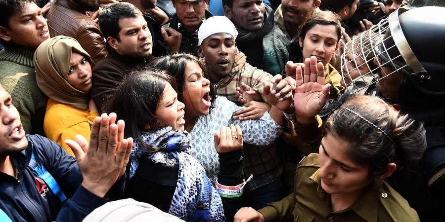 Police stop protestors during their march against the CAA, NCR and NPR outside Jamia Millia Islamia campus on February 10