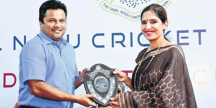 TNCA president Rupa Gurunath presenting the Rajah of Palayampatti Shield to Ajay Kudva, cricket in charge of Jolly Rovers, for being 1st Division champs (2018-19).