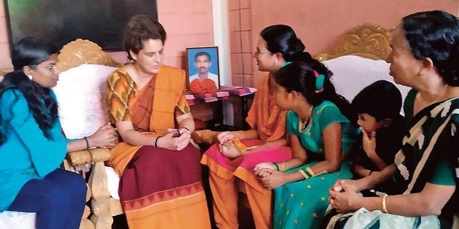 Priyanka Gandhi Vadra interacting with family members of CRPF jawan Vasantha Kumar, a martyr of Pulwama attack, in Wayanad in 2019, shortly after the incident.