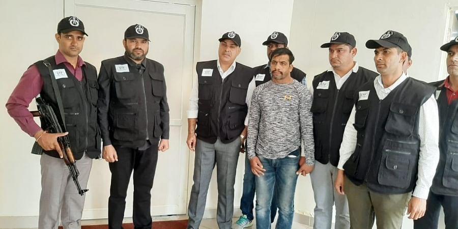 Raju Basaudi (in grey) with Haryana Police team