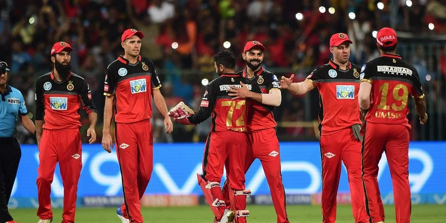 Royal Challengers Bangalore players celebrates after winning the match against Sunrisers Hyderabad during their IPL T20 cricket match 2018 at Chinnaswamy Stadium in Bengaluru on Thursday.