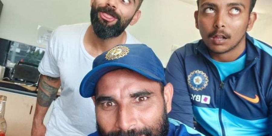 Kohli tweeted with a picture of him, Shami and young Shaw making faces at the camera.