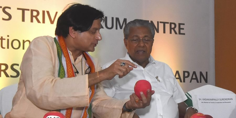 Shashi Tharoor, MP, describing the Daruma doll, a traditional handmade Japanese wishing doll, to Chief Minister Pinarayi Vijayan during the inaugural session of 'Discover Japan' festival in Thiruvananthapuram on Friday