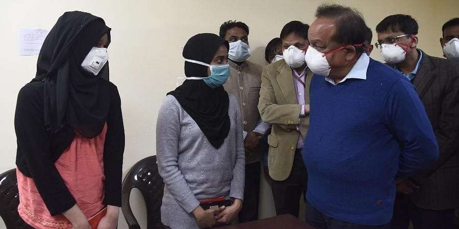 Union Minister of Health and Family Welfare Harsh Vardhan interacts with students who were air-lifted from Wuhan, in New Delhi.