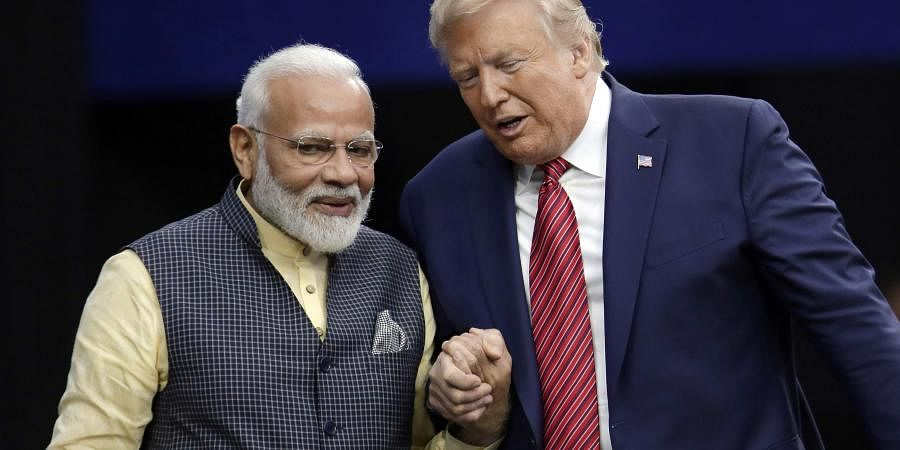 President Donald Trump shakes hands with Indian Prime Minister Narendra Modi during the 'Howdy Modi: Shared Dreams, Bright Futures' event at NRG Stadium, Sunday, Sept. 22, 2019, in Houston.   (Photo   AP)