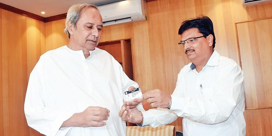Finance Minister Niranjan Pujari presenting a copy of the Digital Budget 2020-21 to Chief Minister Naveen Patnaik at Assembly in Bhubaneswar on Tuesday.