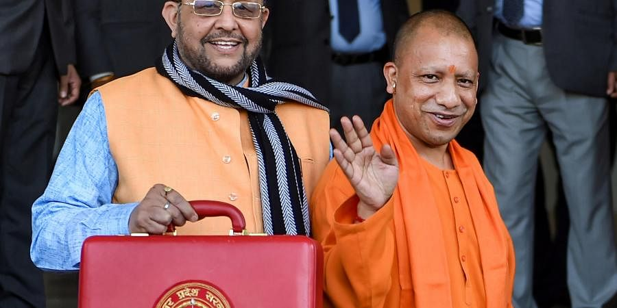 Uttar Pradesh Chief Minister Yogi Adityanath R and Finance Minister Suresh Khanna before the presentation of State Budget 2020-21 in the UP Legislative Assembly in Lucknow Tuesday Feb18 2020.