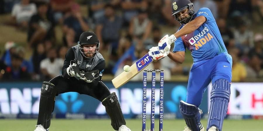 Rohit Sharma (R) bats watched by New Zealand's Tim Seifert (L) during the fifth Twenty20 cricket match. (Photo | AFP)