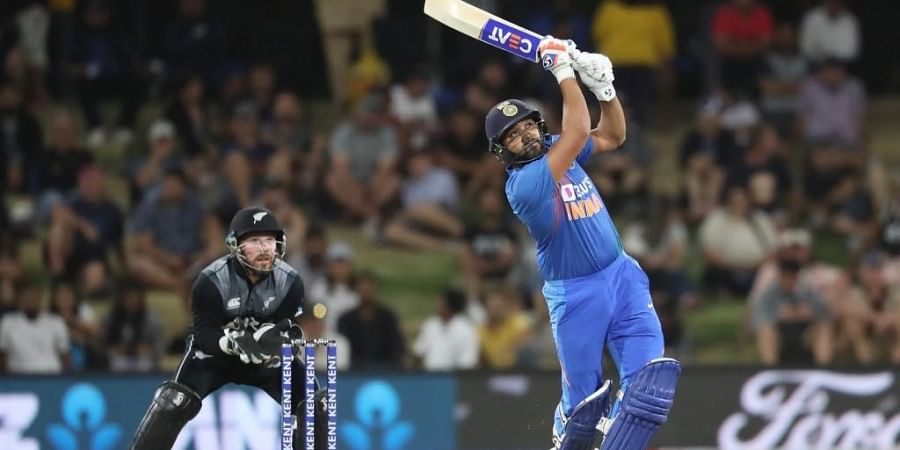 Rohit Sharma (R) bats watched by New Zealand's Tim Seifert (L) during the fifth Twenty20 cricket match. (Photo   AFP)