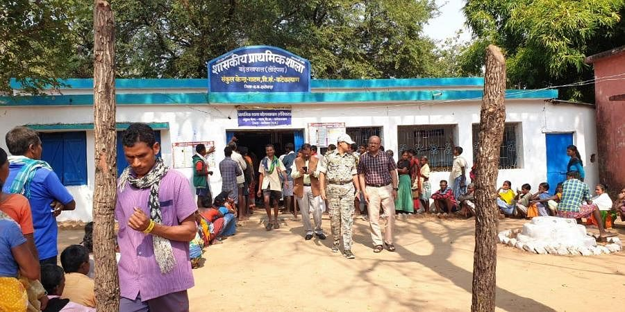 Surrendered Maoists awaiting their turn in a queue to exercise their right to vote in panchayat polls