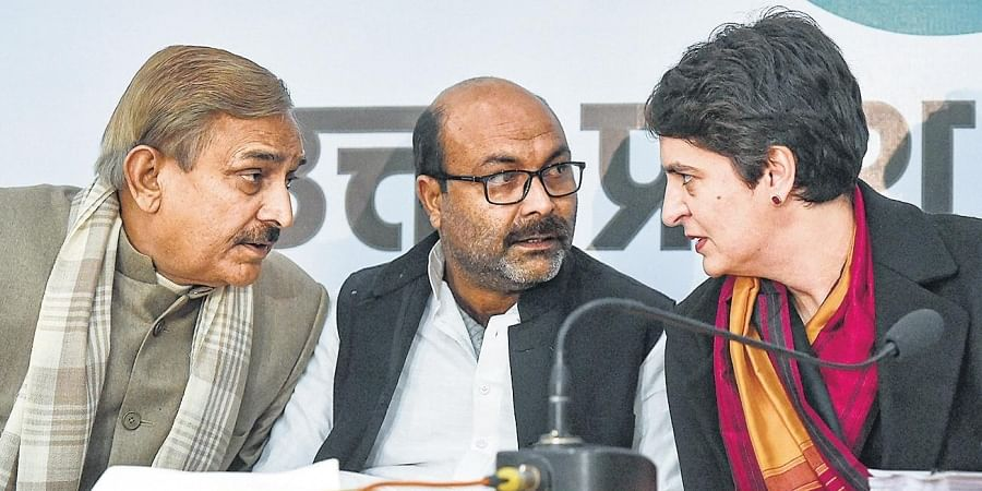 Priyanka Gandhi Vadra with party leaders Pramod Tiwari and Ajay Kumar Lallu at a press conference in Lucknow.