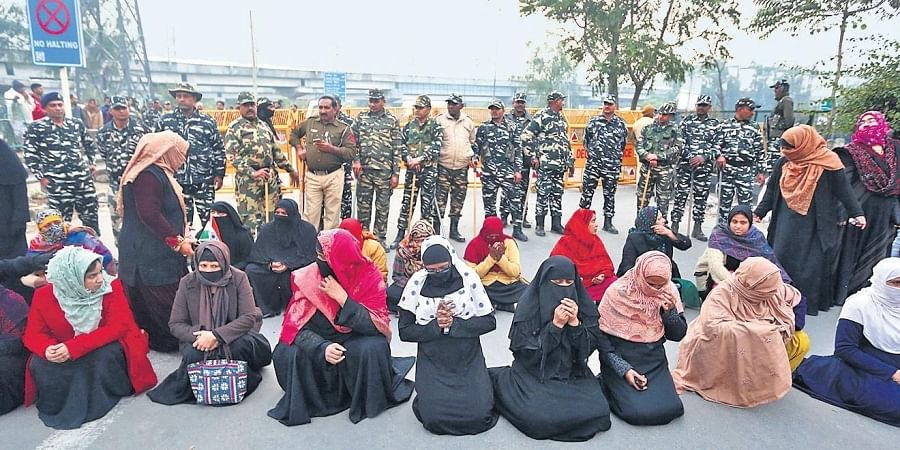 After a person allegedly opened fire in Shaheen Bagh, women protesters gathered to pray at the spot where the incident took place | SHEKHAR YADAV