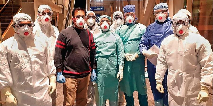 Doctors and other team members of the specially-prepped Air India's B747 aircraft wait to receive the Indian students, stranded amid the coronavirus outbreak, at the airport in Wuhan on Saturday | PTI