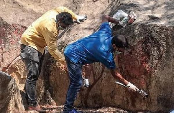 As good as old: Ugly Indian scrubs graffiti off Cubbon Park rock