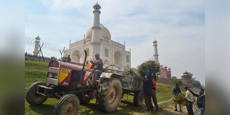 Taj Mahal in Agra being cleaned ahead of Donald Tump's visit. (Photo| PTI)