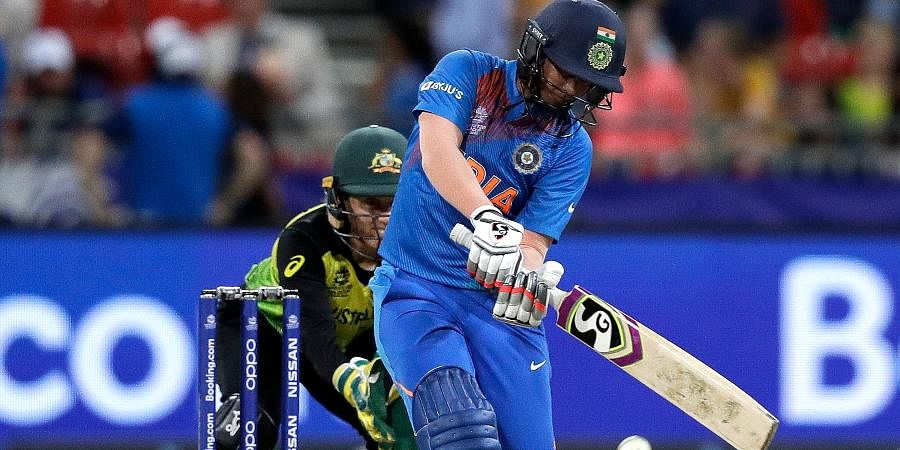 Deepti Sharma, right, drives the ball against Australia during the first game of the Women's T20 Cricket World Cup in Sydney.