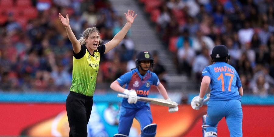 Australia's Ellyse Perry, left, successfully appeals for a LBW decision on India's Jemimah Rodrigues, center, during the first game of the Women's T20 Cricket World Cup in Sydney.