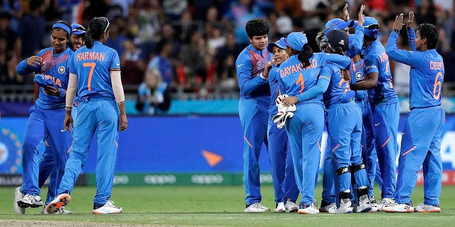 The Indian team celebrate their win over Australia in the first game of the Women's T20 Cricket World Cup in Sydney.