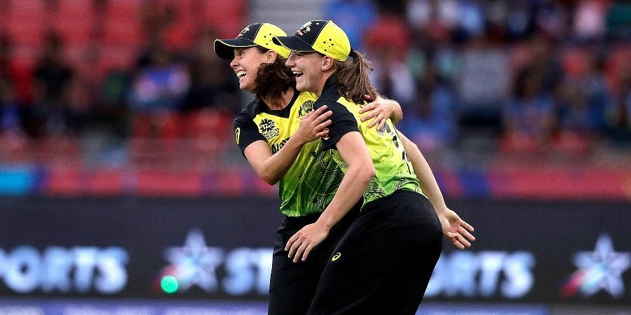 Australia's Molly Strano, left, and Annabel Sutherland celebrate the wicket of India's Shafali Verma during the first game of the Women's T20 Cricket World Cup in Sydney.
