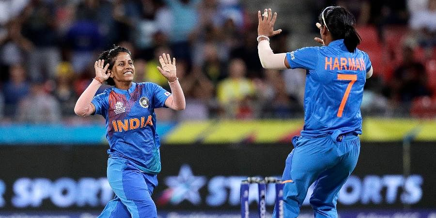 India's Poonam Yadav, left, celebrates with teammate Harmanpreet Kaur after taking the wicket of Australia's Jess Jonassen during the first game of the Women's T20 Cricket World Cup in Sydney.