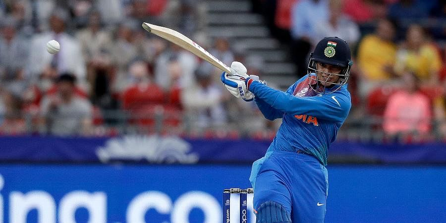 India's Smriti Mandhana hits a boundary off Australia during the first game of the Women's T20 Cricket World Cup in Sydney.